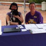 greeters at welcome booth