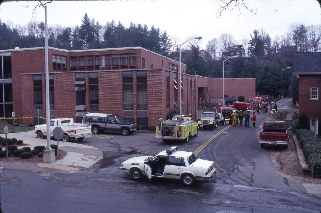 Area fire crews assess building safety and damage.