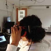 Photo of student using VR room.